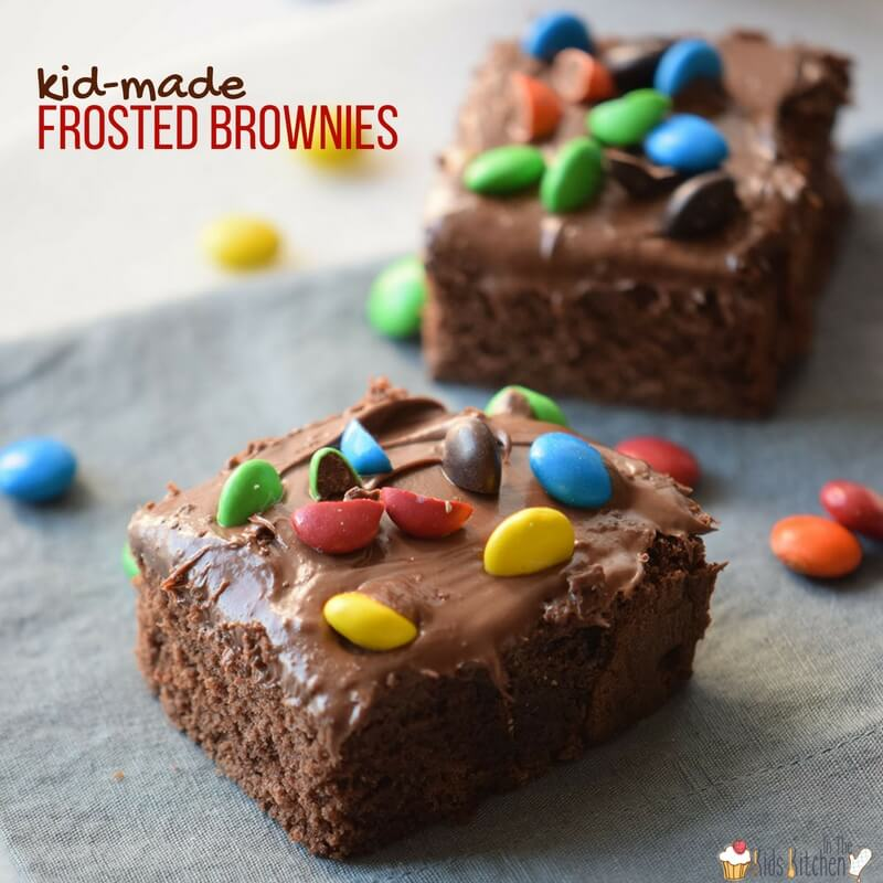 A triple-chocolate dessert delight! Fluffy chocolate cake brownies with rich, fudge icing...topped with M&Ms. Kid-made and oh-so-yummy!