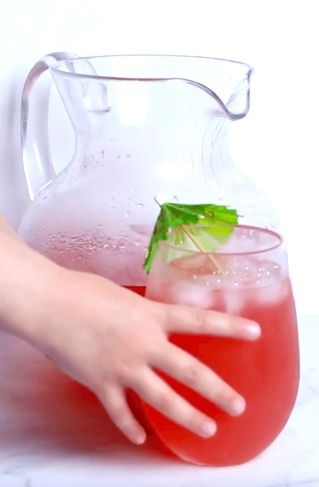 fruit punch in glass with paper umbrella