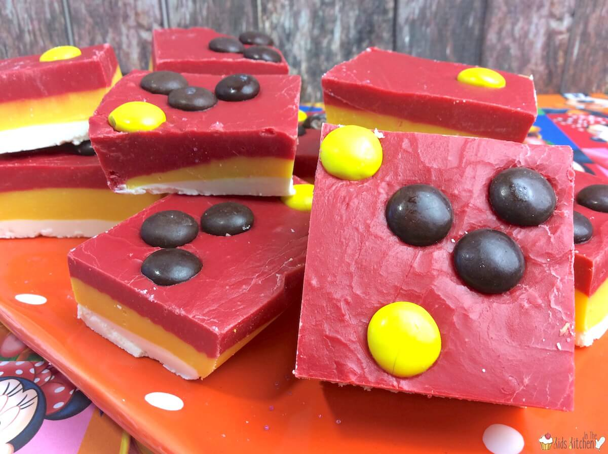 This cute and colorful Mickey Mouse Party Layered Fudge will WOW kids and grown-ups alike! Easy dessert recipe perfect for birthdays, holiday, or anytime!