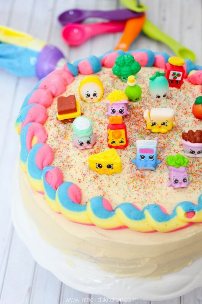 You'll never believe how easy it is to make this stunning Rainbow Shopkins Cake! Perfect for your favorite Shopkins fan or for a themed kids birthday party!