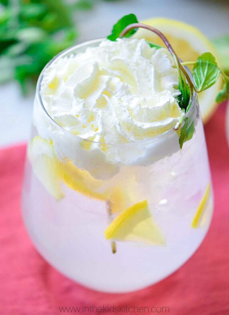 sparkling lemonade in glass with whipped cream