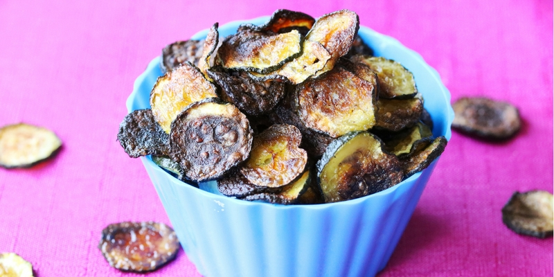 These crispy baked zucchini chips have all the crunch kids love in potato chips - and they're healthier! A win-win snack that's easy to make at home.