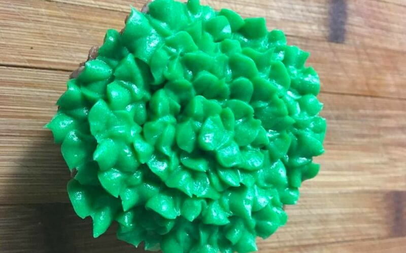 green frosting on cupcake