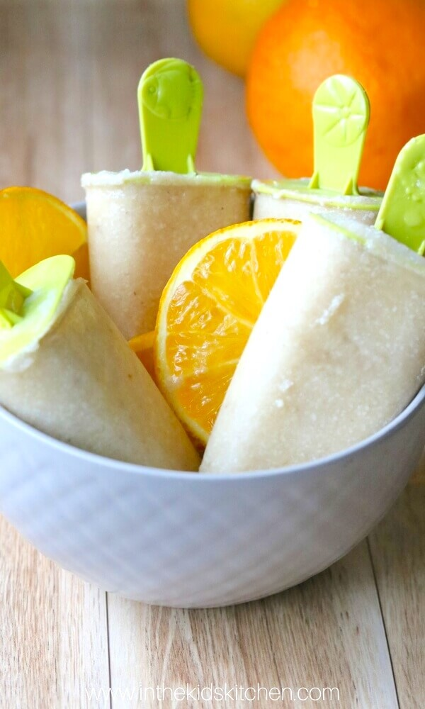 Orange Banana Cashew Milk Popsicles are rich, creamy, and bursting with tropical fruit flavor! An easy, high protein and dairy free dessert.