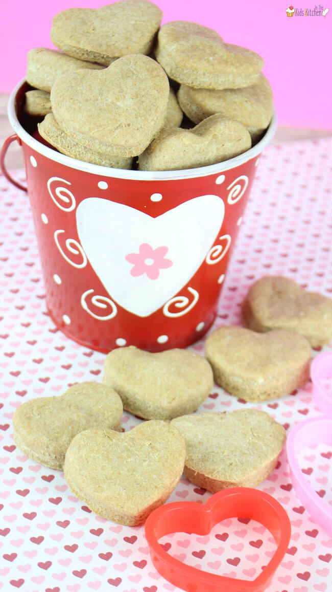 Show your furry best friend how much you love them with these heart shaped peanut butter dog treats! An easy homemade dog biscuit recipe using simple ingredients.