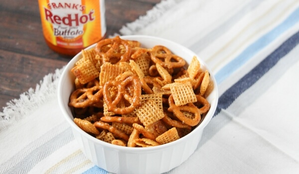 The perfect combination of sweet & spicy - Buffalo Chex Mix is addictively crunchy and the perfect party appetizer! Click for easy photo step-by-step instructions.