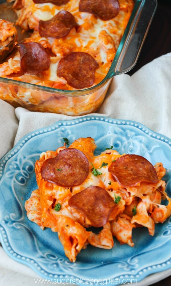 pizza pasta bake on blue plate with pepperoni