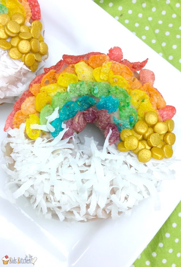 An easy shortcut recipe to make rainbow decorated air fryer donuts. Perfect for St. Patrick's Day or kids birthday parties!