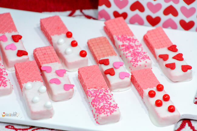 These white chocolate dipped Valentine's Day Wafer Cookies are an easy no bake treat that's perfect to make in a pinch for classroom parties and gifts! Colorful and super tasty too!