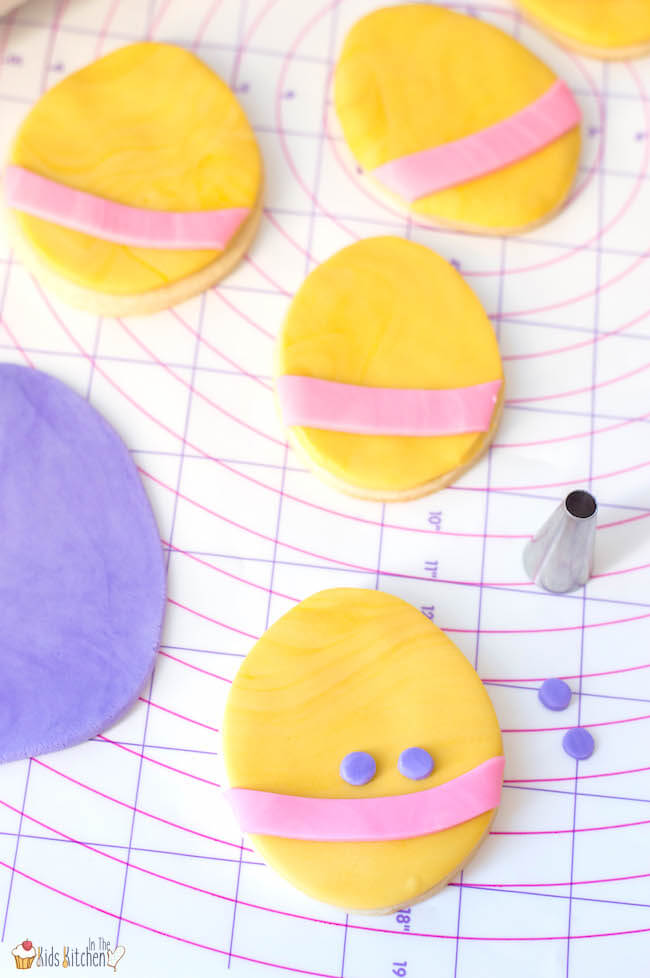 decorating Easter egg sugar cookies with pastel fondant