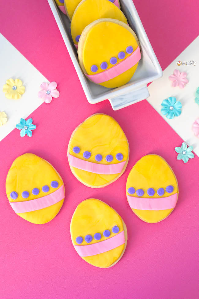 These cute Easter Egg Cookies are easy for kids to make using a sugar cookie mix shortcut and colorful fondant!
