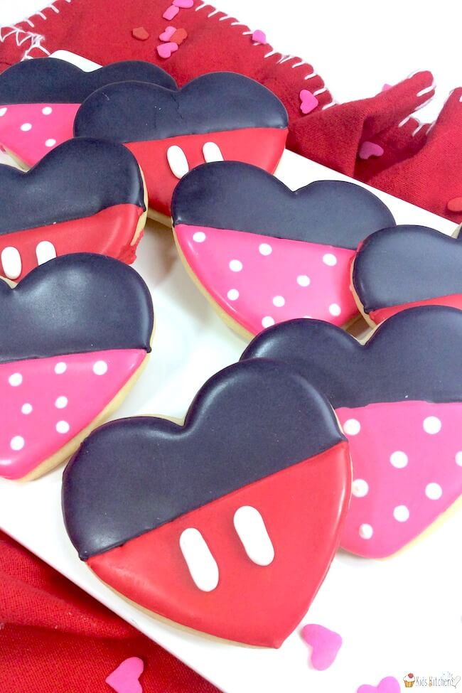 A fun Valentine's Day cookie recipe, these Minnie and Mickey Mouse Heart Cookies will make any Disney fan's day!