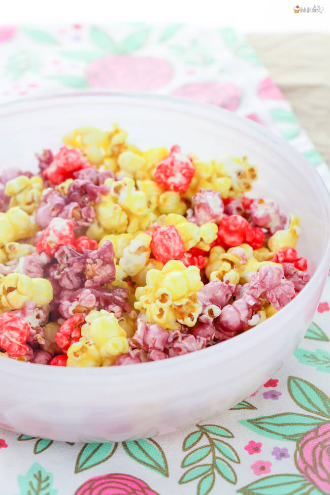 Sweet and colorful — candy coated Jello popcorn is the perfect Spring treat!