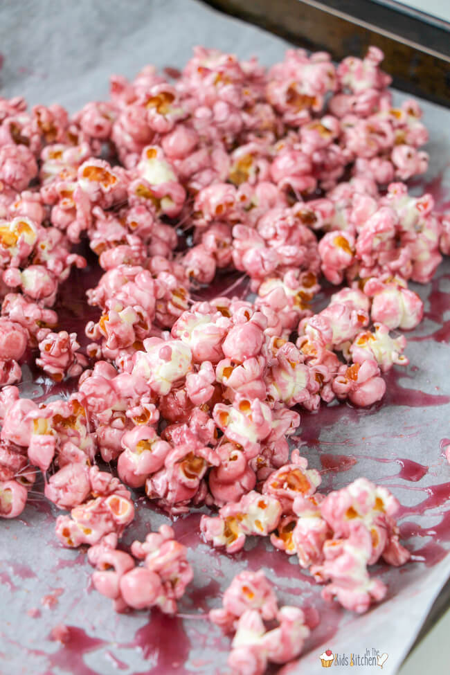 Candy coated popcorn on cookie sheet